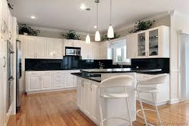 white kitchen cabinets with black counter top