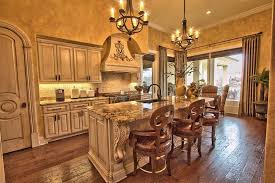 bewitching kitchen interior with wrought iron chandeliers in black color above rectangle cabinet