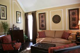 wall decor frames ideas living room traditional with old world leather ottoman old world