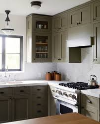 gray green paint for cabinets. remodelista - colorful kitchen cabinets gray green paint for