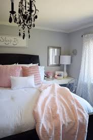 Create a romantic bedroom with bright whites and pale blush and pink  bedding from HomeGoods.