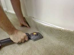 use knee kicker to attach carpet to tackless strip
