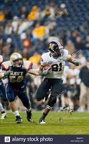 Navy linebacker Tony Haberer gets a hold of Missouri wide receiver ...
