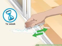 image titled clean sliding glass door tracks step 6