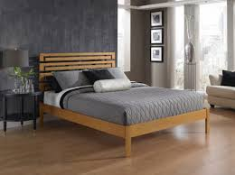 View in gallery A modern wooden platform bed