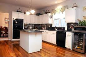 white kitchen cabinets with black appliances antique white kitchen cabinets with black appliances kitchen wall colors
