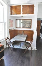 the cutest little built in dining area in a small living e