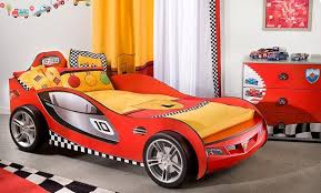 Racing Cars Themed Boys Bedroom with Yellow Twin Bed Cover, F1 Painted  Drawer Storage, F1 Painted Drawer Storage, and Race Flag Decorated Carpet