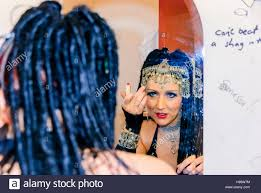 a belly dancer prepares her makeup backse before a performance