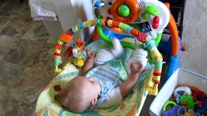Our baby boy -3 months old- kicks light toy - YouTube