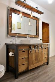 reclaimed wood bathroom vanity with metal details and the same mirror