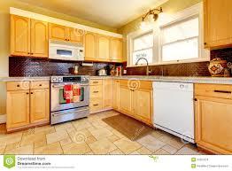 light hardwood floors with dark cabinets. Kitchen Charming Floor Tiles With Light Cabinets Tones Kitchens Oak And Wood Floors Brick Backsplash Design Hardwood Dark I