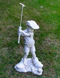boy playing golf garden statue bring a little whimsy to your landscaping with a statue