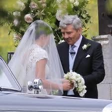 Bridesmaid Princess Charlotte and pageboy Prince George threaten.