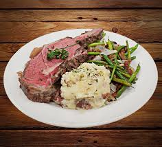 Place beef on vegetables, cover; Prime Rib Crest Bar And Grill