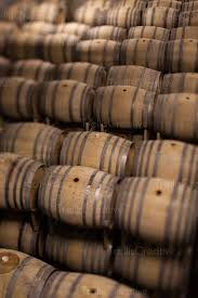stacked oak barrels. Winery Cellar Filled With Stacked Oak Wine Barrels. Barrels E