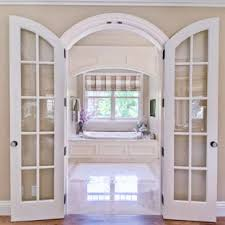 example of a midsized classic master white tile dropin bathtub design in arched french doors l88