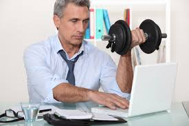 a man exercising while working