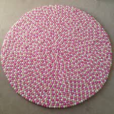 shining round pink rug 2 felt ball in light white sand