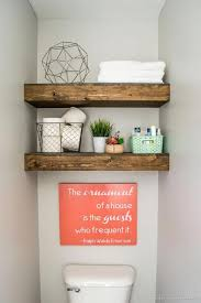 this farmhouse bathroom nails its decor with reclaimed wood shelves to spare towels toilet paper and simple decorations