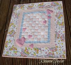 The Nifty Stitcher: Hearts Baby Quilt Tutorial & This quilt measures 26
