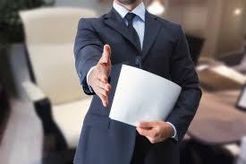 implementing career development programs langley james stretta di mano uomo in ufficio per colloquio di lavoro