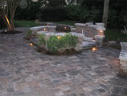 paver patio with fire pit and lamps