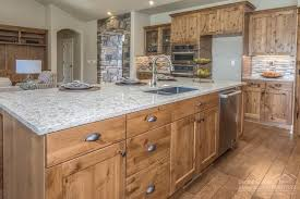 alder kitchen cabinets pros and cons rustic kitchen the knotty alder cabinets and natural stone floor