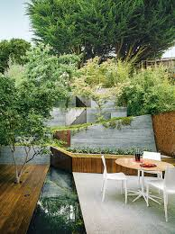 Japanese Landscape Designer A White Granite Patio Furnished With A Petal Dining Table By