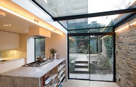 minimal windows sliding doors to side infill extension with glass roof  above supported by steel T