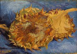 two cut sunflowers on blue background exchanged to gauguin