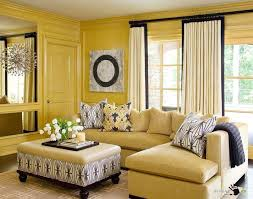 beige sectional living room sofa set with pillows and blanket also large wall mirror decor and modern decorating with yellow