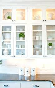 love the little pops of green in with clean white dishes glass cabinet doors kitchen