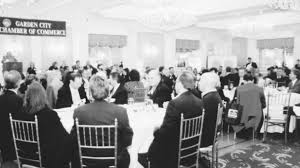 the ballroom at the garden city hotel was packed with chamber members and guests who heard