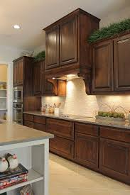 Knotty Alder Wood Cabinets Burrows Cabinets Kitchen Cabinets In Stained Knotty Alder And