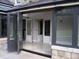 aluminium patio cover surrey: bi fold timber doors  x bi fold timber doors