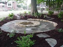 Flagstone Patio Around Natural Stone Fire Pit Progressive Lawnscaping