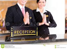 royalty free stock photo chinese asian reception team at hotel front desk