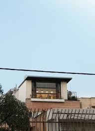 Small And Modern Apartment On The Roof Of An Old Building