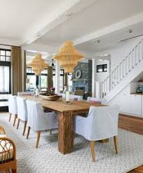 coastal farmhouse dining room with jute twine chandeliers coastal farmhouse dining room with two chandeliers and slipcovered dining chairs chairs