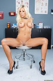 Blonde Doctor Stripping And Revealing Massive Tits photos Nina.
