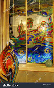 colorful abstract on glass vase blend perfeclty with paintings on window stained glass mural