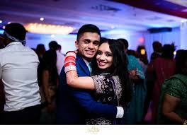 bride and brother dancing at an indian wedding reception at the park savoy in florham park