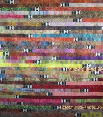 Quilt Inspiration: Spaghetti, potato chips and jelly rolls & Kay Koeper Sorenson created this marvelous quilt which includes a dramatic  black-and-white accent fabric; the accents are used as