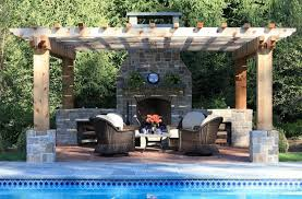 stunning outdoor wood burning fireplace design with living space and natural stone chimney near home swimming