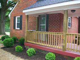 exterior wood railing. minimalist brown brick stoned wall and grey roof tile also wooden front exterior wood railing