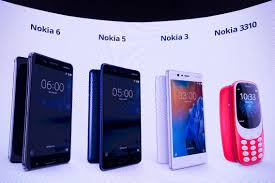 nokia phone models 2017. new phone models by nokia are displayed on a screen during the presentation of 2017