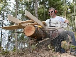 diy alaskan chainsaw mill using bucking stands