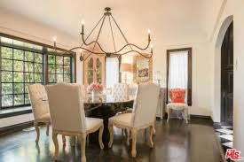 the dining room looks elegant with its table and chairs set and chandelier