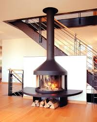 free standing wood burning fireplace living room contemporary fire focus hearth logs metal railing modern stand